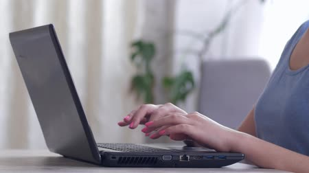 correspondência : women hands open the laptop computer and type text on the keyboard then closes the computer sitting on workplace