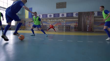 вратарь : KHERSON, UKRAINE - APRIL 02, 2019: Football goal, sport Team of soccer players pass ball to score touchdown at sports hall