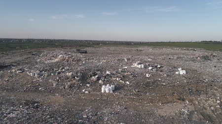 biological danger : garbage on landfill, drone view on man running along city dump household waste and flying seagulls over large rubbish piles Stock Footage