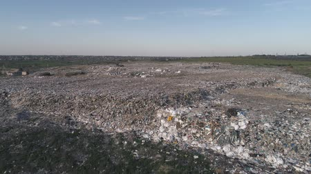 biological danger : city dump, aerial view on landfill with pile garbage and flying gulls feeding on food waste in slow motion