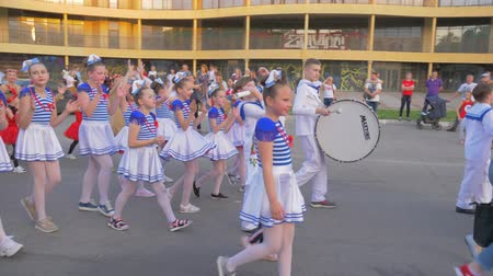 festividades : KHERSON, UKRAINE - MAY 20, 2019: Festival Melpomene of Tavria, holiday parade, many children in different costumes walk along city street and shout chants on open air