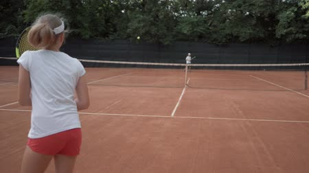 contestant : tennis game, sports player adolescent girl with contestant hitting racket on ball pass through net to each other at court during championship