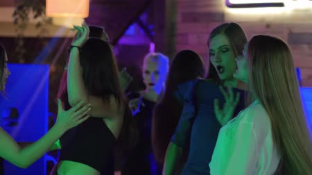 şahsiyet : dancing in a night club, young women actively dancing on the dance floor of a disco during a bachelor party