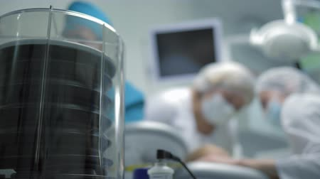 narcosis : oxygen device, equipment for the respiratory system is working in a medical clinic during an operation, doctors are not in focus during work Stock Footage