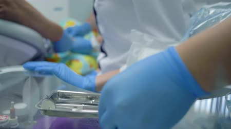 intravenous drip : preparation for surgery, unpacking of medical instruments for oral cavity with a doctor in gloves in a stomatological office Stock Footage