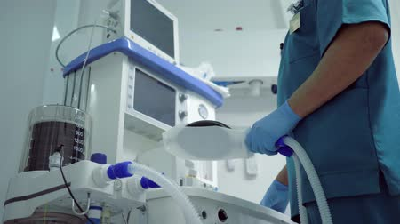 narcosis : innovative medicine, in clinic before operation they check modern medical equipment for supplying oxygen to patient under general anesthesia Stock Footage