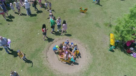 organizar : KOZACHI LAGERYA, UKRAINE- JUNE 01, 2019: happy children, joyful kids have fun playing in playground and riding on swing during fun weekend on International Children Day