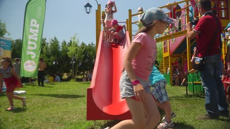 organizar : KOZACHI LAGERYA, UKRAINE- JUNE 01, 2019: children holiday, group of kids actively spend time running and riding on the playground during the summer holiday