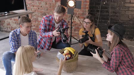 fotoshoot : photo master class, young photographers learn to take pictures of fruits in a basket with use cameras and mobile phone with equipment in a studio