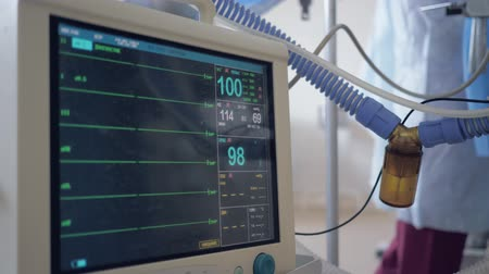 vital signs : monitoring vital sign of patient under anesthesia in operating room, cardiogram monitor showing human heart rate during surgical operation