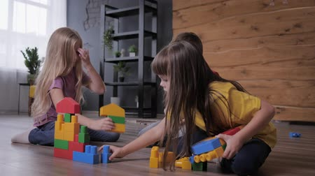 ロジック : educational games, friendly children have fun playing in a colorful constructor and build unusual toys from details 動画素材