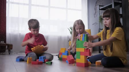 construtor : funny children are passionate about playing the constructor play and collect toys from colored parts and blocks for speed, who is faster