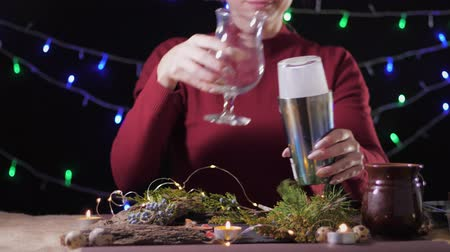 metodo : holiday season, homemade traditional egg drink in a glass with ground nutmeg and cinnamon decorating with christmas tree and lights