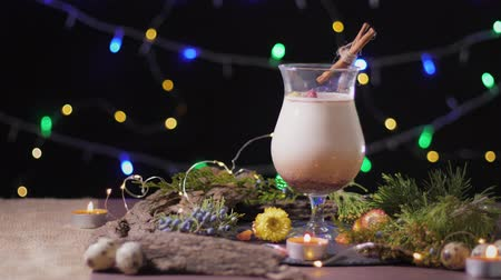 küçük hindistan cevizi : season eggnog, handsome cocktail glass with a traditional egg drink on decorated with christmas tree and lights