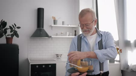 peppy : healthy products, Influencers an elderly smiling man in glasses for eyesight who cares about health talks about cereals holding food in hand