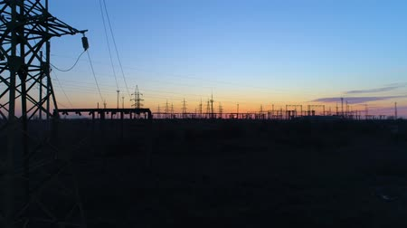 パイロン : energy efficiency, silhouette of towers and high voltage power lines at dusk, aerial view