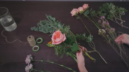 dekoratör : hobbies, professional woman florist works in a modern floristic salon and makes a creative bouquet of fresh flowers for sale in a store, small business concept