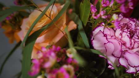 stylish bouquet of flowers made for delivery or sale of a florist shop by a professional creative florist, close-up Stock Footage
