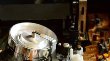 videocassette : Cassette videotape recorder inside. Dolly shot Stock Footage