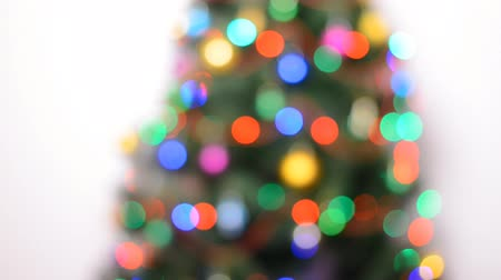 blinking light : Blurred Green Christmas Tree with Gifts and Bulbes Blinking