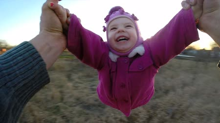 hiç kimse : Slow Motion. Man Rotates His Little Daughter Outdoor, First Person View From