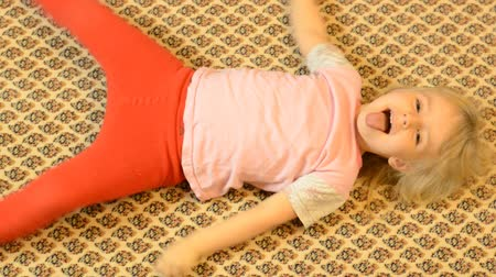 výraz : Happy Child Lying on a Carpet, Crazy  Emotions