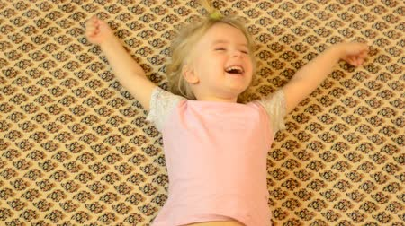 szőnyeg : Happy Child Lying on a Carpet, Crazy  Emotions