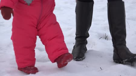 babygirl : Newborn  Baby Girl Walking Shes First Steps in a Winter Day. 4K UltraHD, UHD Stock Footage
