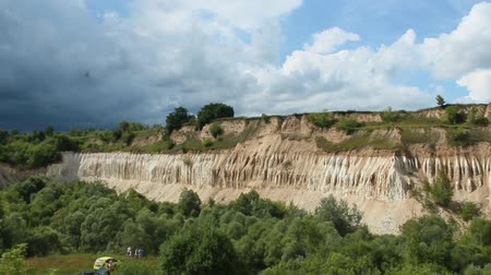 old pit : Cretaceous quarry. Landscape with sandy cliffs and beautiful sky. Cretaceous pit. Sandy cliffs with forest at foot. Sandy mountains. Celestial landscape with deposits of chalk Stock Footage
