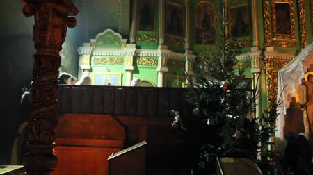 Church choir singing prayer song in church during service in Troizckiy monastery Stok Video