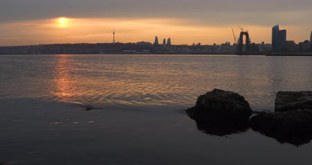 city park : 4k Panorama of the seaside boulevard in Baku at sunset day