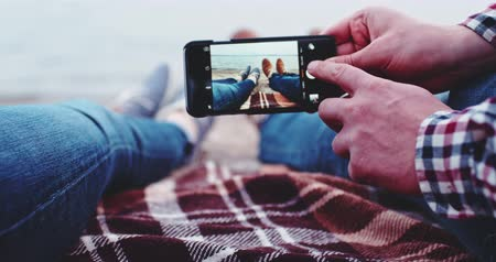 resimlerinde : Point of View: Man and Woman hands Using Smartphone, Taking Feet Picture with Photo App, Slow Motion 4K, DCi. Couple making photos on the beach near lake, creating memories. Social network, technology