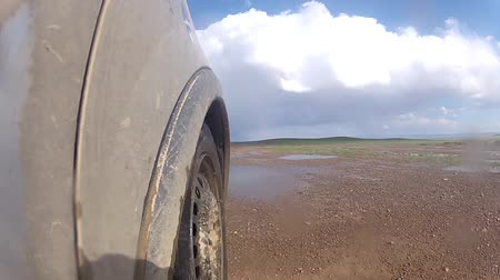 wyscigi : Car in motion by dirt road. View from vehicle  Wideo