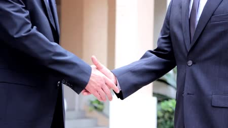 zawód : Two business people handshake
