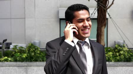 corporativa : Handsome hispanic businessman talking at phone