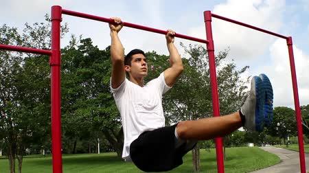 fitnes : leg lifts. outside environment. Gym training