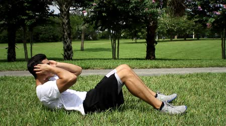 fogyás : Male exercising abs. sit-ups workout. side view Stock mozgókép