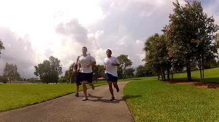 fitnes : young men running in park.