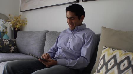 touchpad : handsome Man at home using tablet