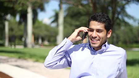 kapatmak : Happy businessman talking at phone.