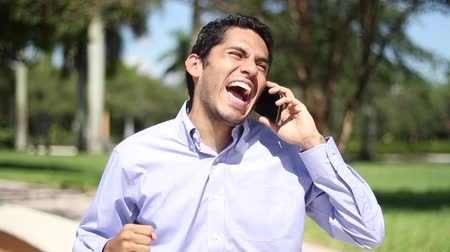 izgatott : Happy businessman. great news.  talking on the phone. Stock mozgókép
