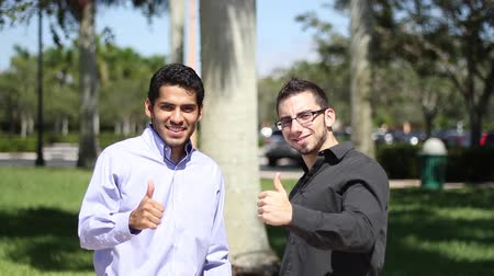 profi : Businessmen with thumbs up looking to the camera Stock mozgókép