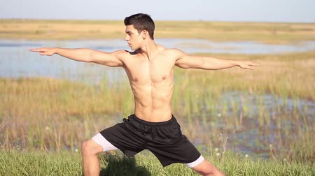 dengelemek : Young man doing yoga. Peaceful environment. Outdoors