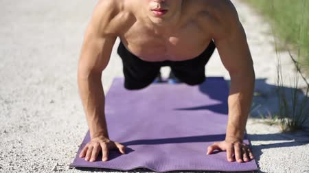 fitnes : Young caucasian male in sportswear doing push ups