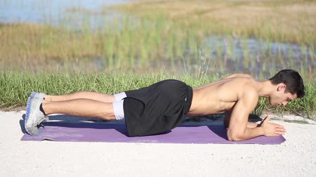 fitnes : male in plank position works out exercise