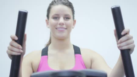 striving : Walking Machine. woman exercising in the gym. Stairmaster Stock Footage