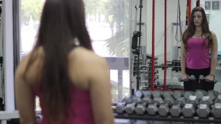 aerobic : beautiful young woman exercising in gym. Shoulders