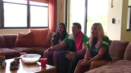 латинский : Group of happy Mexican soccer fans. Goal Celebration