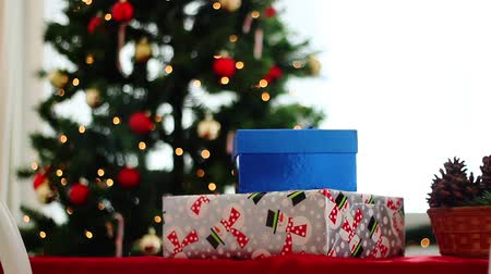 erkeklere özel : Christmas presents in front of tree, dolly movement