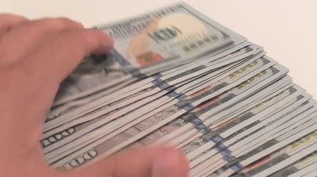 dolar : Close-up of a hands counting new one hundred dollar bills